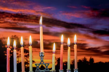 Chanukah Menorah in the Jewish festival of lights beautiful sky with cloud before sunset Banco de Imagens - 130814144