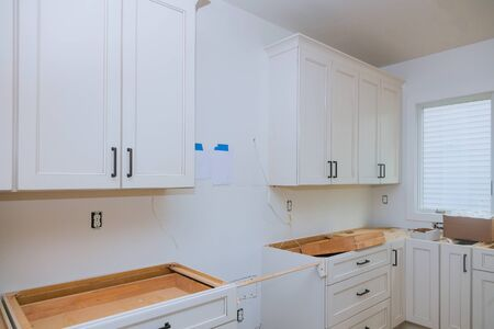 White of kitchen wooden cabinets with contemporary of installation base