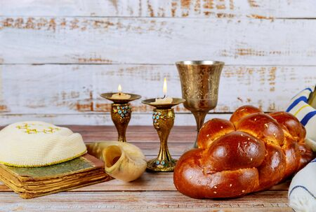 Shabbat challah bread, shabbat wine and candles on the table Jewish Holiday