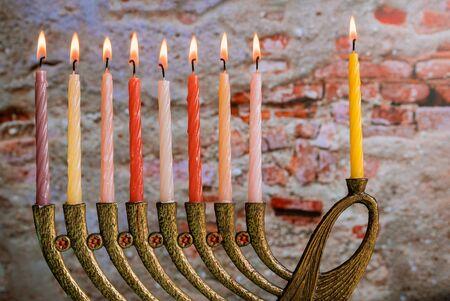 Menorah for the jewish holiday burning hanukkah candles in a menorah Reklamní fotografie
