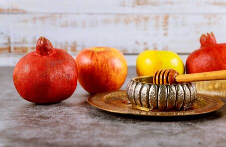 A jewish new year with honey for the apple and pomegranate holiday of Yom Kippur and Rosh Hashanah Jewish prays