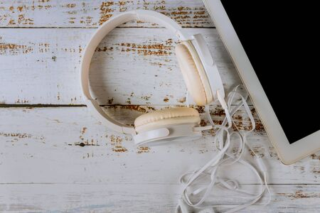 Digital tablet an old wood with headphones concept of music. Imagens