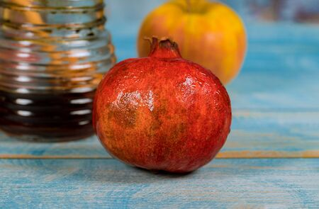Table in the synagogue are symbols of Rosh Hashanah apple and pomegranate