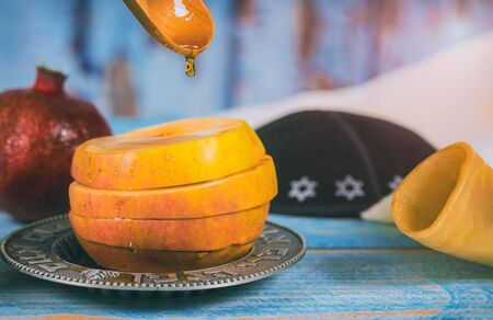 Jewish Holiday Rosh hashanah honey and apples with pomegranate traditional symbols