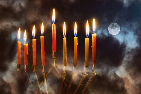 Menorah with candles for celebration with beautiful full moon night sky of jewish holiday Channukah channukiah menorah background Фото со стока