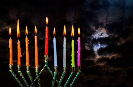 Chanukah Jewish holiday background with full moon in the evening Hanukah menorah Judaism candelabra burning candles