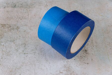 Blue painter tape for multi surfaces on white wall background Reklamní fotografie