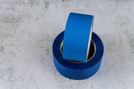 Set of blue painter plastic duct tape over the white background