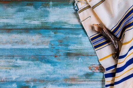Shofar horn and tallit jewish holiday with Orthodox hassidic Jews pray