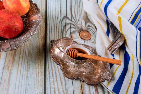 Honey, apple and pomegranate for traditional holiday symbols rosh hashanah jewish holiday Stock Photo