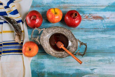 Rosh hashanah with honey and fresh ripe apples. Jewish new year symbols shofar and tallit