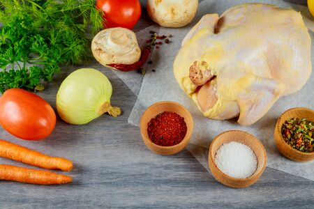 Set of products for making organic raw chicken on wood with fresh ingredients for broth