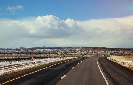 Dramatic crisp winter highway in winter snow covers the desert of Tucson, Arizona Banco de Imagens