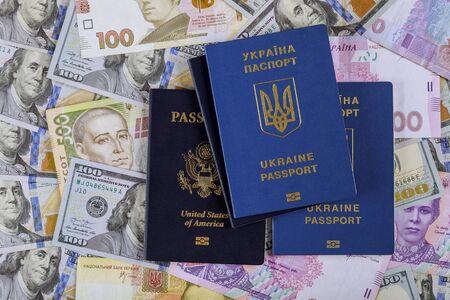 Ukrainian passport with dual citizens US Passport hryvnia banknotes and US dollar bills