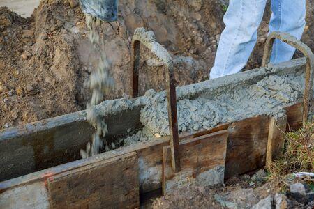 Sidewalk renewal road infrastructure repair of concrete blocks frame of flat