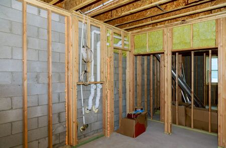 New residential construction home framing electrician power supply with basement view