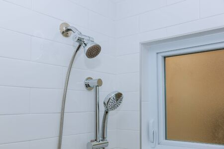 Shower head in modern bathroom with new home construction