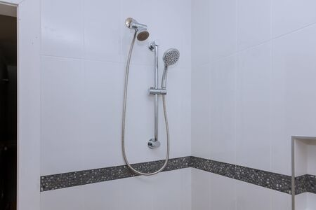 Shower head in private bathroom, design of home interior