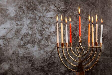 Jewish holiday Hanukkah menorah with burning candles Stock Photo