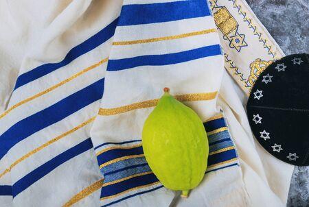 Traditional symbols Jewish festival of Sukkot Etrog, lulav, hadas, arava praying book kippah Tallit Jewish ritual
