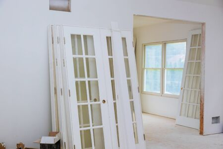 Interior construction of housing project with door and molding installed construction materials Stockfoto