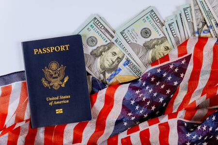 National symbol USA flag on top of American dollar banknotes in different positions and US Passports