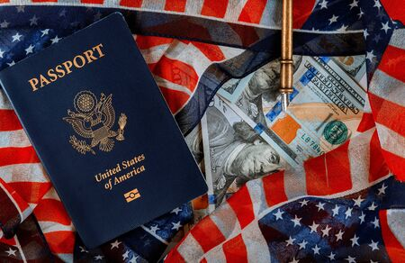 US passport and flag USA as a patriotic over a cash of hundred dollar bills Stock fotó