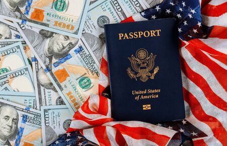 American passports on top of American flag in the US currency American dollar banknotes different positions.