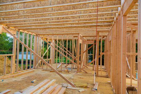 New construction of beam construction house framed the ground up framing against a blue sky Banco de Imagens