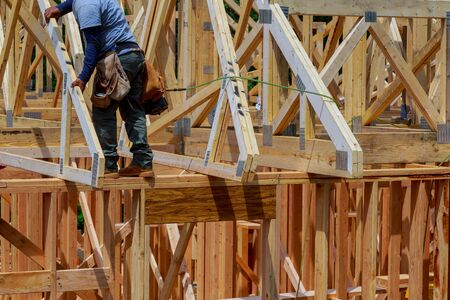 Wooden beam house roof residential construction home framing Banco de Imagens