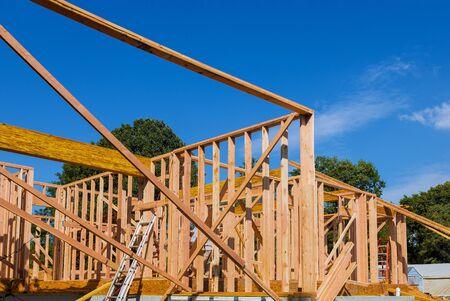 New house beam construction framing wooden house tiled roof Banco de Imagens