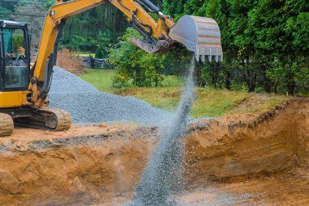 Industrial excavator for foundation building construction site, bucket details, dirt gravel all around Banco de Imagens
