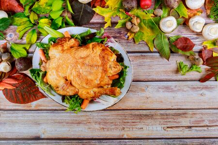 Traditional Thanksgiving dinner roasted chicken on wooden table Stok Fotoğraf