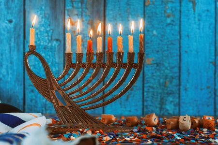 Golden menorah with flaming candles in the Chanukah Jewish holiday