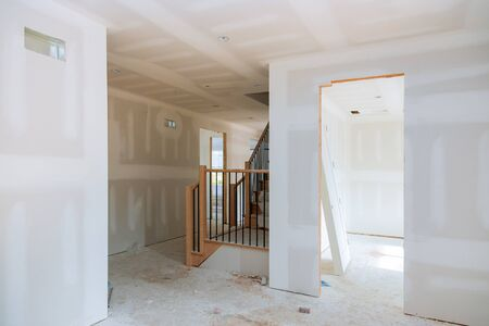 walls plasterboards with room under construction with finishing putty in the room Фото со стока