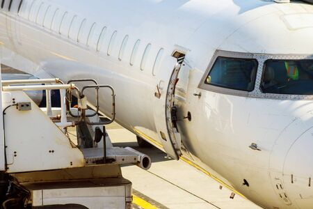 Jet engine against a middle size plane at the airport on loading aircraft at the International Airport