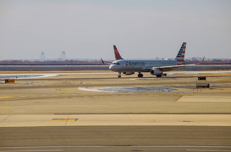 FEB 14, 2019 JFK NEW YORK, USA: Delta Airlines jet planes, airport terminal gates Servicing F. Kennedy International Airport. Delta Airlines