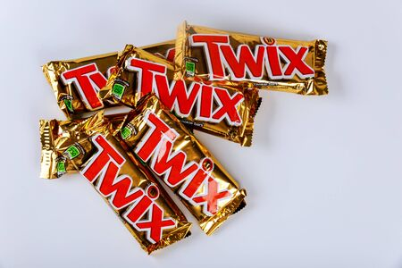 OCTOBER 22 2019 NY USA: Twix is a chocolate bar consisting of biscuit applied with caramel and milk chocolate made by Mars, Inc. on white background Sajtókép