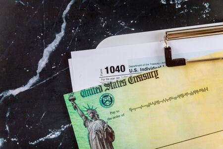 1040 Tax Form with Refund Check and bills US stimulus refund check