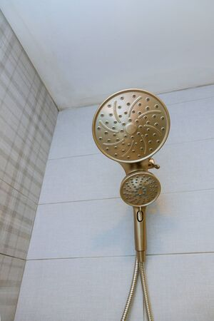 New home shower head in modern bathroom with construction Standard-Bild
