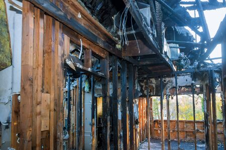 Ruins of house room apartment after a fire charred wooden walls