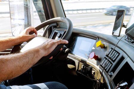 Truck drivers big truck of driver's hands on big truck steering wheel