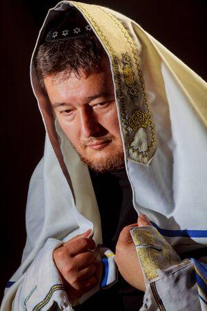 Jewish man wrapped in talit pray religious orthodox Jew with prays