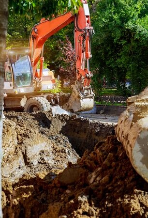 Outdoor work : Excavator digging to moving the soil in construction site,Excavation work