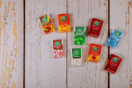 New York NY NOV 08 2019: TIC TAC mint boxes of packages on wood background Editöryel