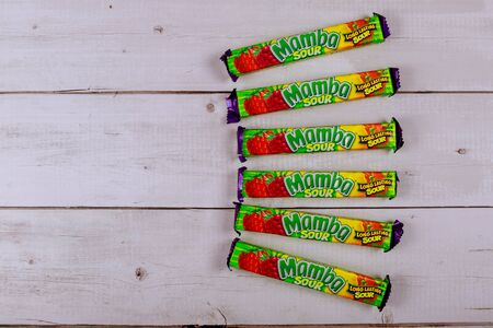 New York NY NOV 08 2019: Mamba chewy candy individually wrapped made by August Storck KG on old wooden background
