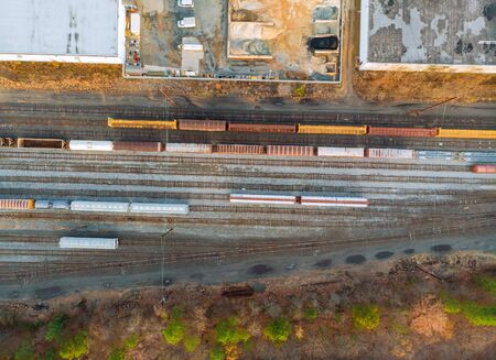 Many wagons and trains aerial view containers in railway station in a sump Stock Photo