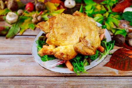 Roasted turkey with corn, carrots and lettuce on plate.