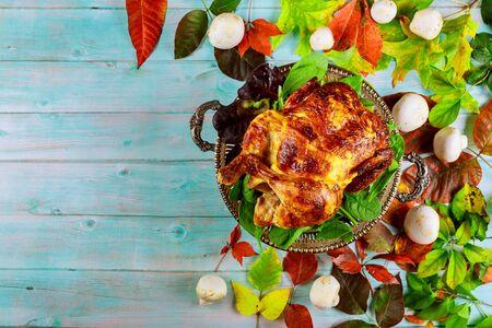 Thanksgiving dinner table with turkey, apple pie, pumpkin.
