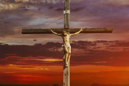 Jesus christ on cross over sunrise he is risen victory in easter day, good friday sunset world christian god religious
